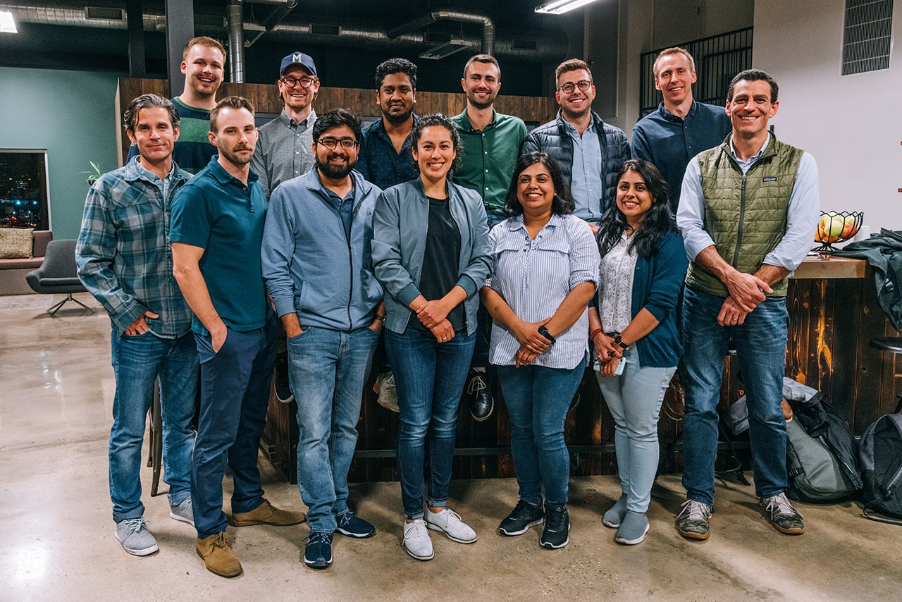 Broad College students and faculty pictured alongside executives from Handsome at its headquarters in Austin, Texas.