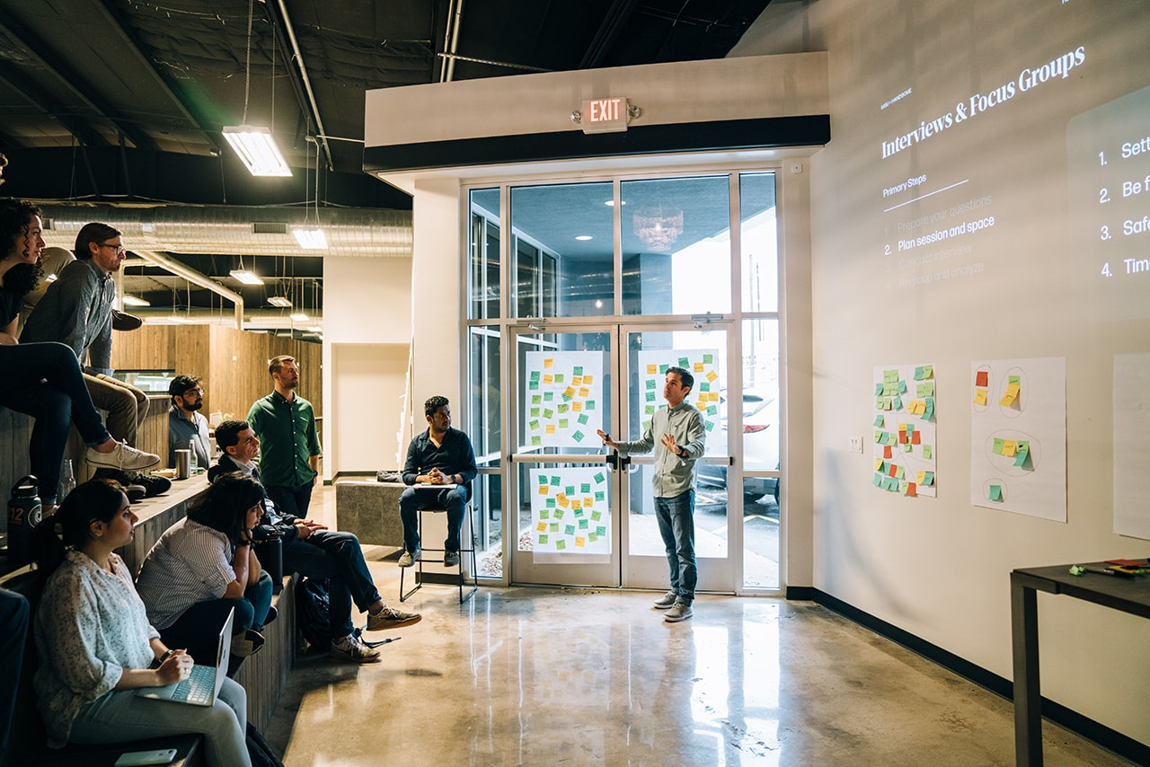 Associate Creative Director of Experience Design and Strategy Travis Rimel speaks to the Broad group about research techniques and focus groups.