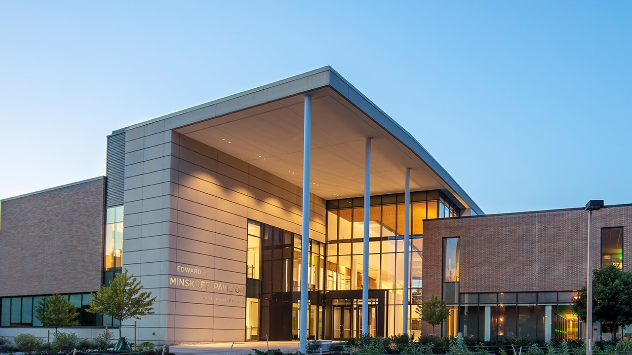 Front, South-facing entrance of the Edward J. Minskoff Pavilion on Michigan State University's campus at dawn.