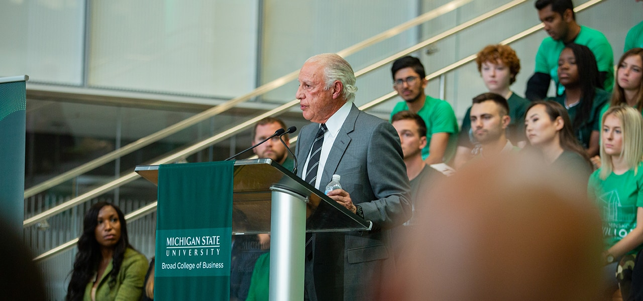Edward J. Minskoff standing at a podium, speaking at the Minskoff Pavilion ribbon cutting ceremony.