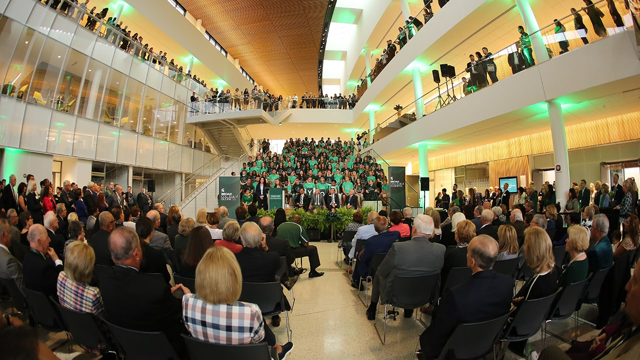 A fisheye view of the Ribbon-Cutting Ceremony with guests filling the Minskoff Pavilion's three floors.
